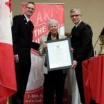 Madelon Kidd (centre) receiving Lifetime Membership.