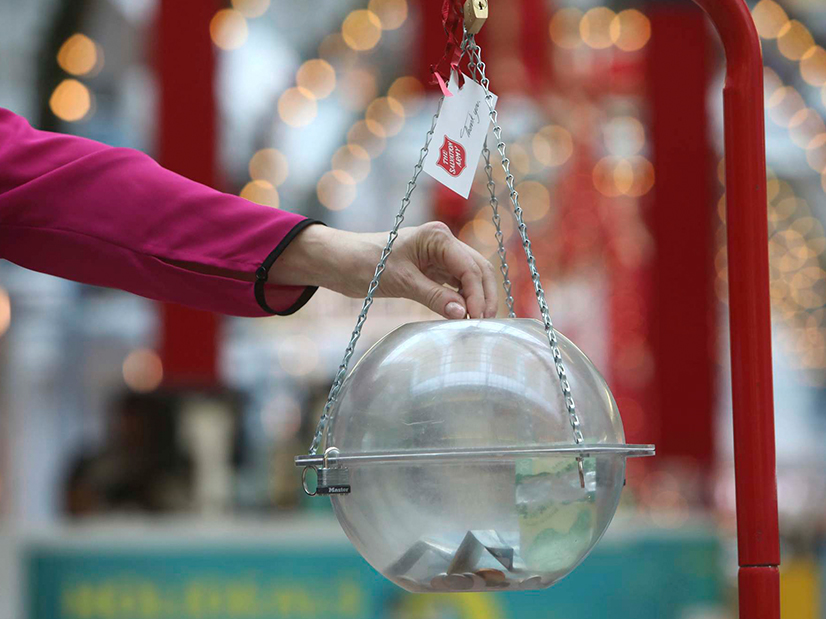 Donating to Salvation Army Christmas Kettle